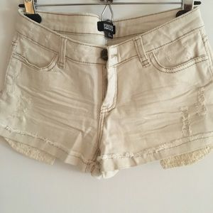 Low rise distressed jean shorts with lace pockets